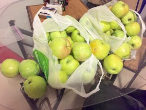 Two big bags of apples.